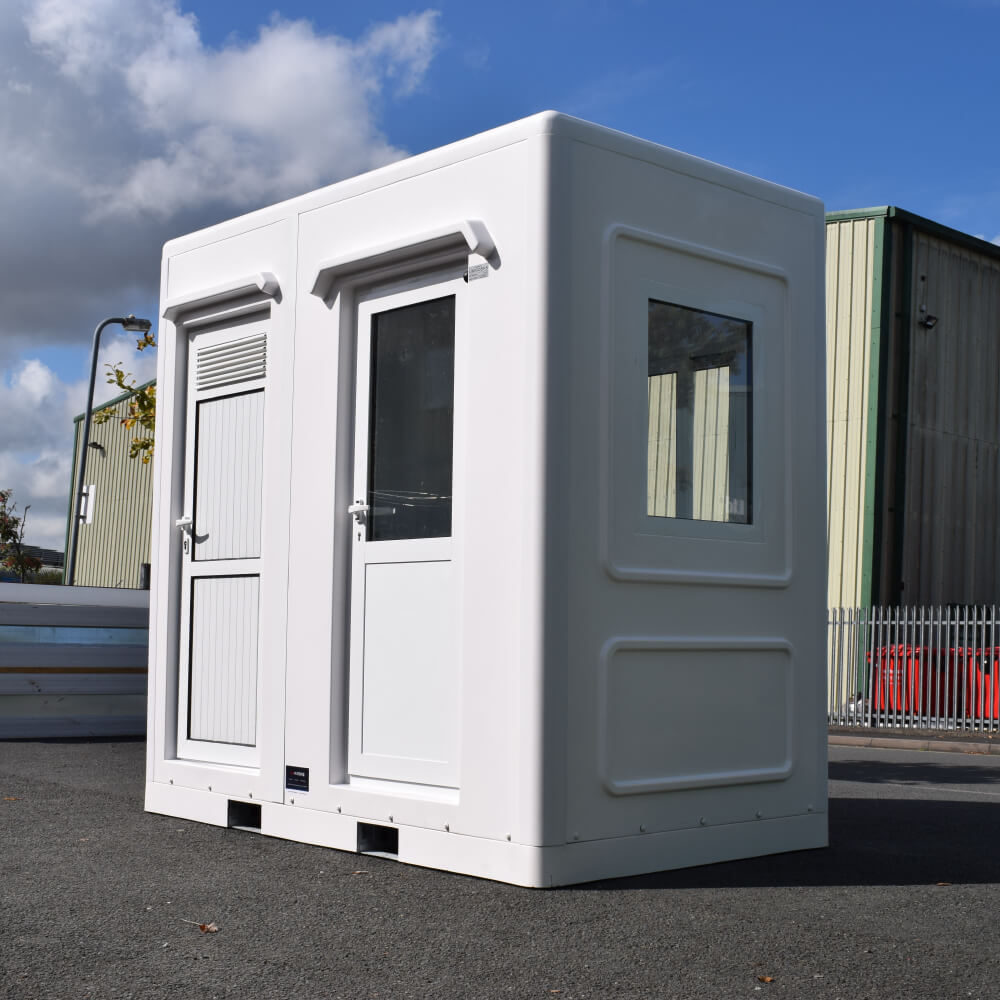 professional photo of a white welfare unit with two doors on a sunny day