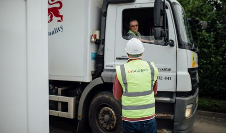 operative communicating with a delivery driver outside uk kiosks