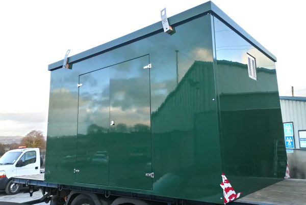 green enclosure on flatbed lorry