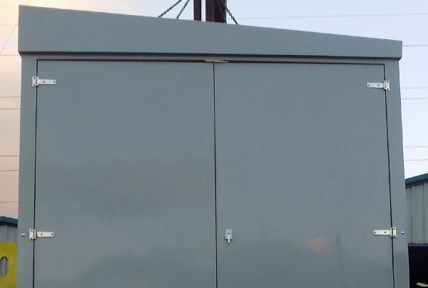 grey grp enclosure being craned