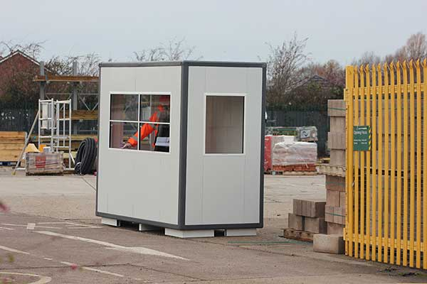 A rental kiosk situated at a car park gate
