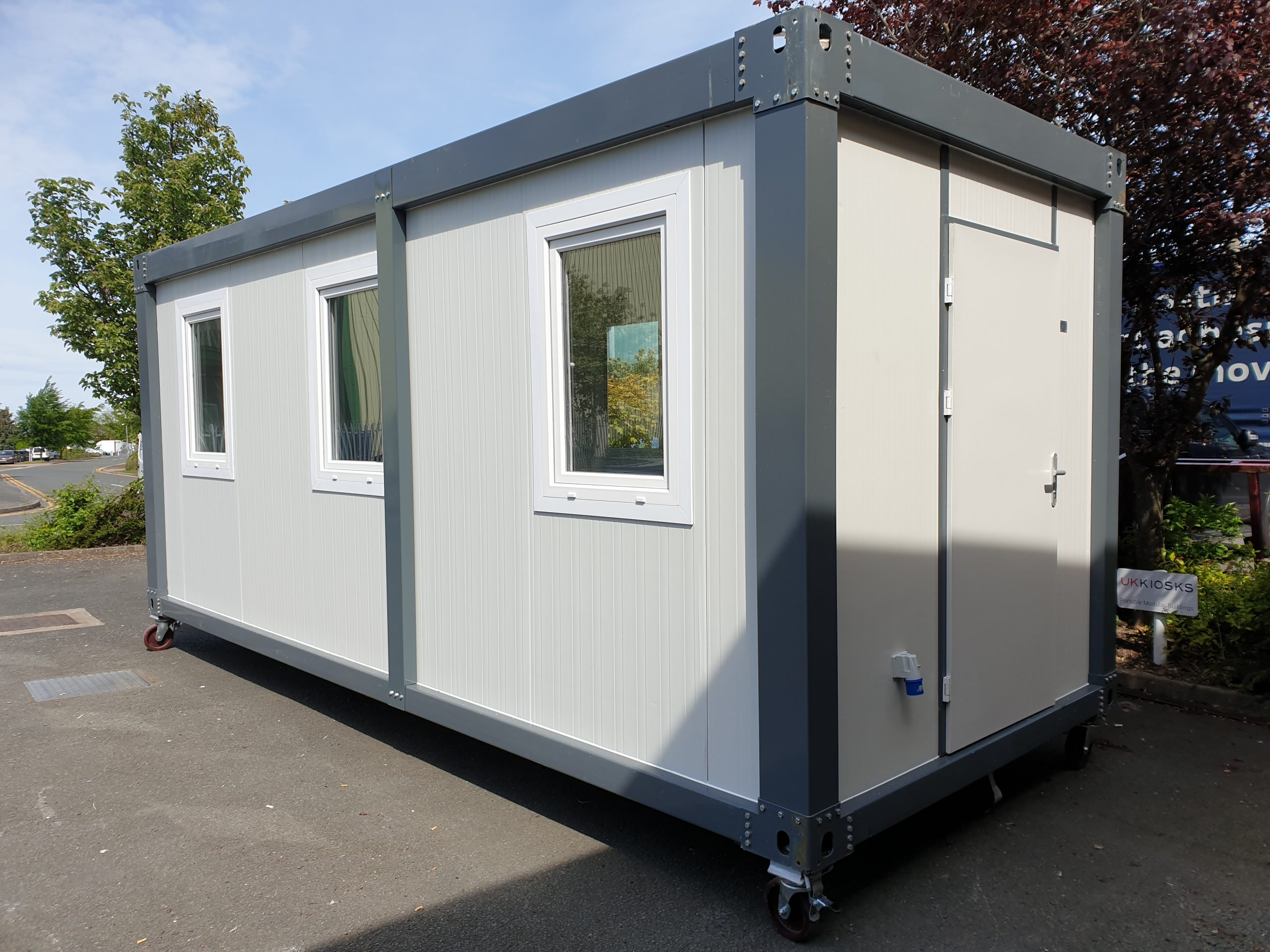 grey steel security cabin with door facing to the right