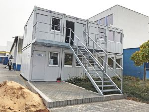 stacked site cabins in grey with external stairs