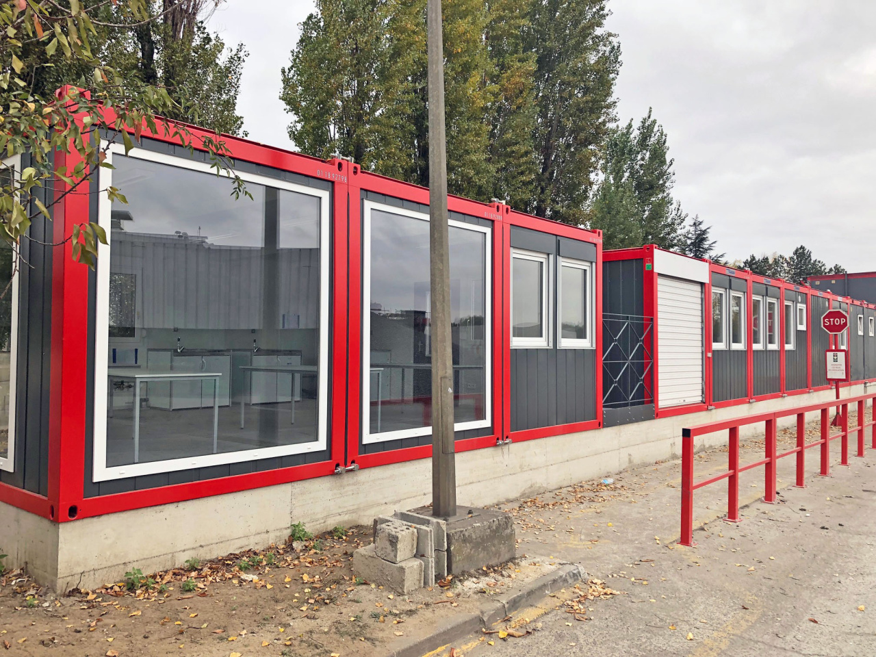 red and black steel portable retail cabins with large full pane windows