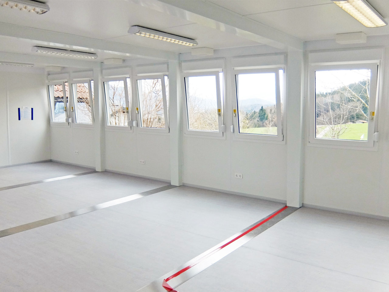 inside a white decorated security cabin with opening windows
