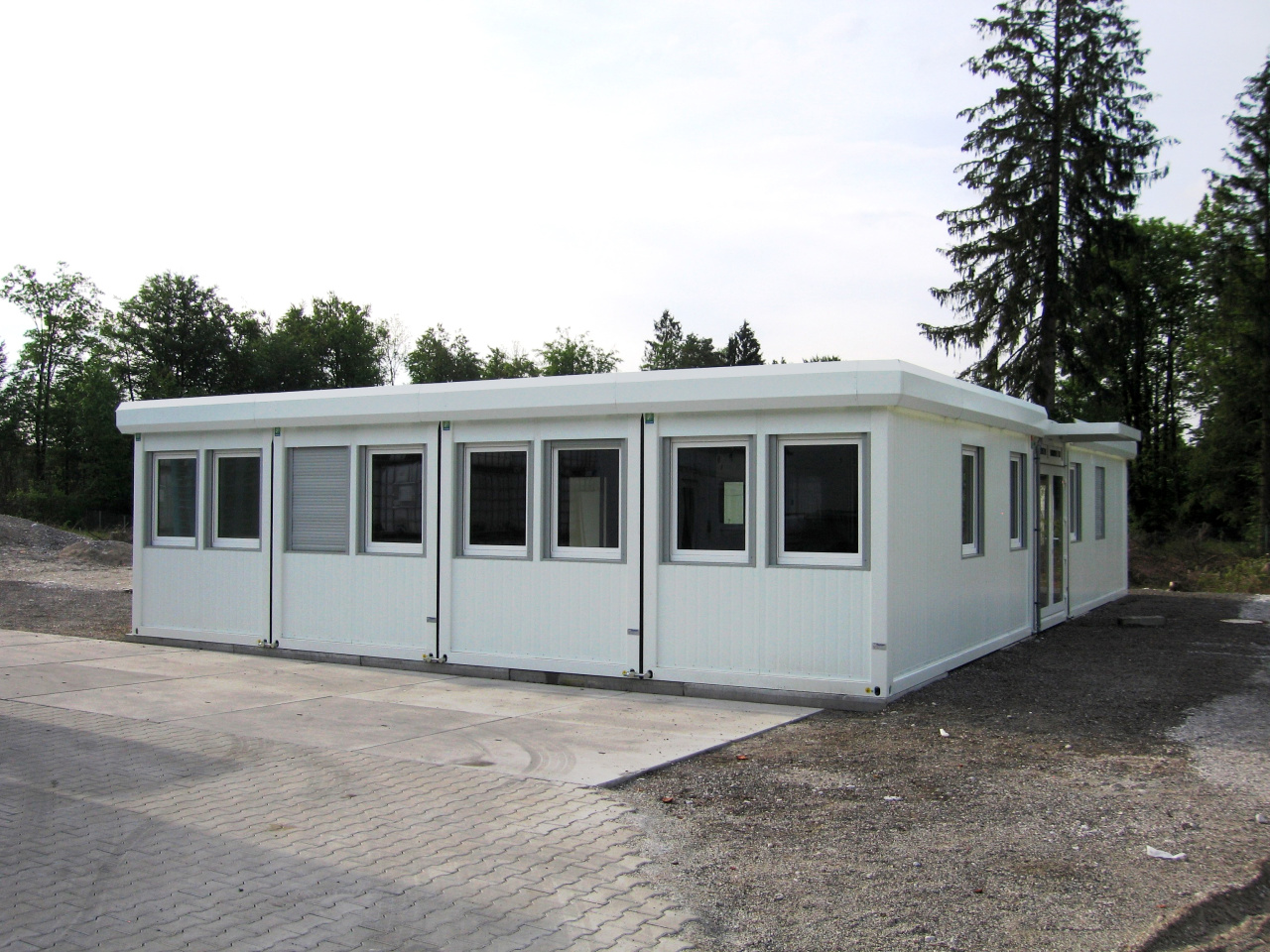 white steel site cabin with 7 windows and security shutters