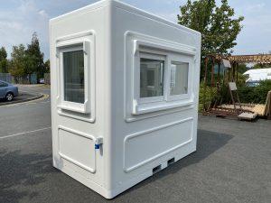 small white kiosk with a double sliding window