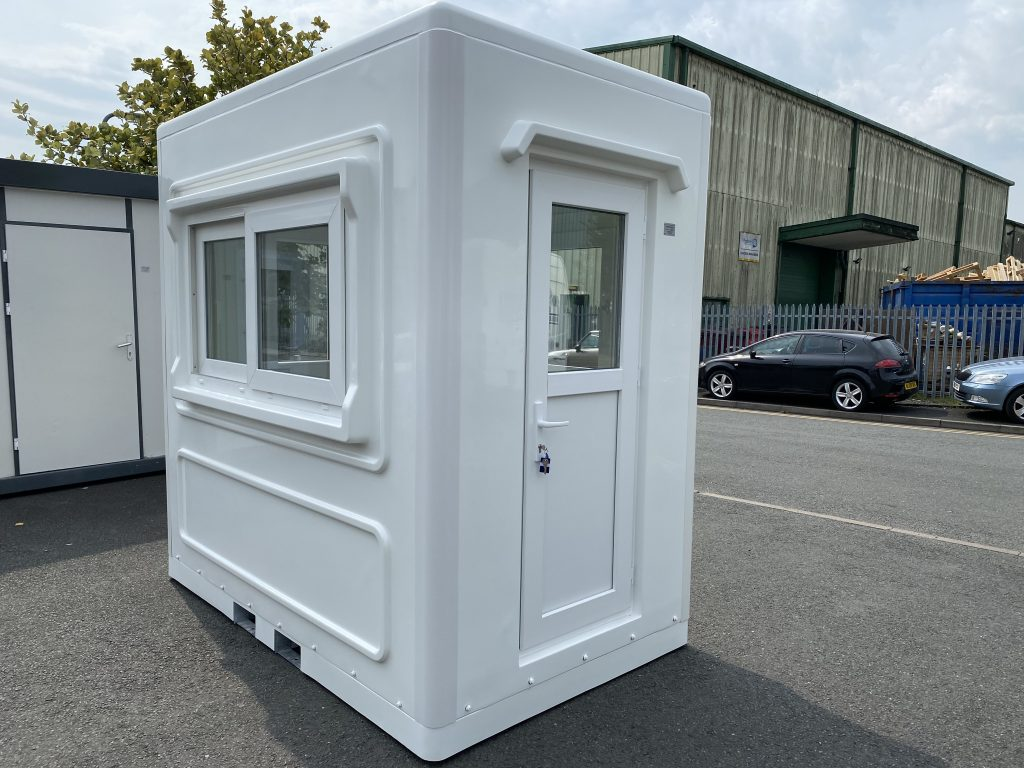 small white kiosk with a sliding window and half glazed door