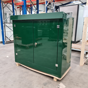 green grp enclosure on a pallet with doors closed