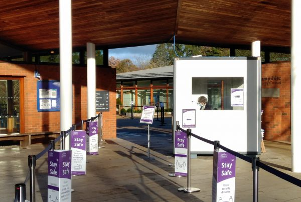 kiosk sat under a canopy with a barrier walkway