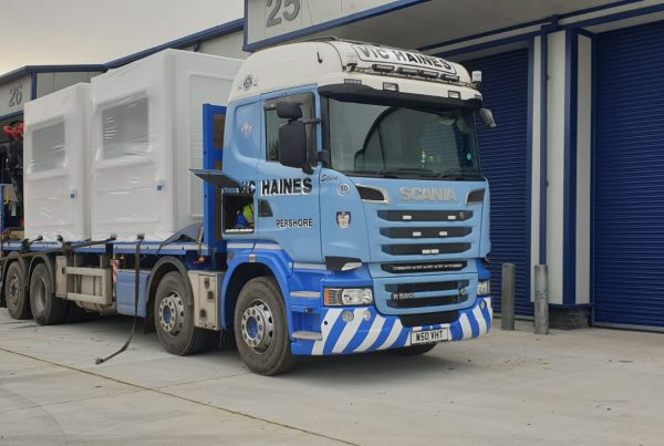 front end lorry with two white kiosks on the bed